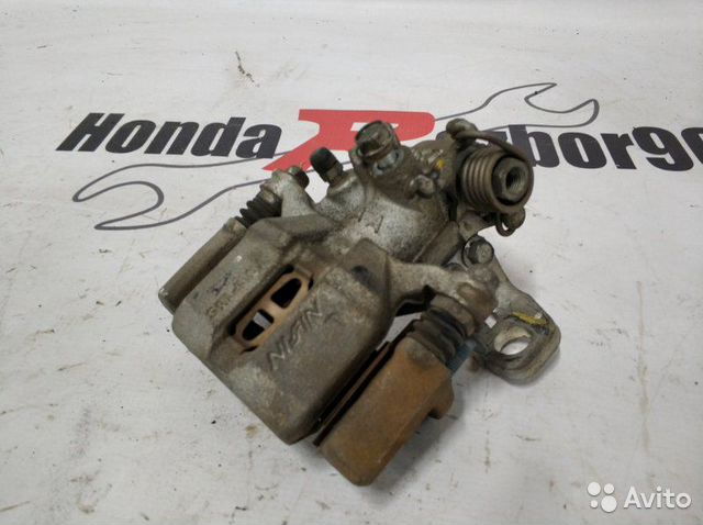 Тормозной суппорт задний левый Honda Fit GE8 GE6  89022570009 купить 4
